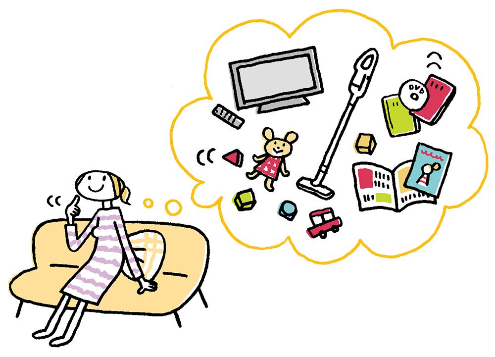 リビングに収納したいもの(掃除機や子どものおもちゃなど)について考えている女性