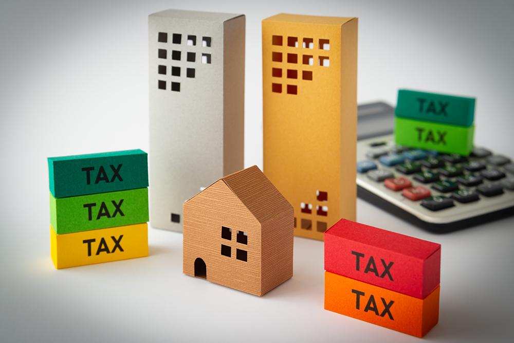 住宅の模型とお金のイメージ画像