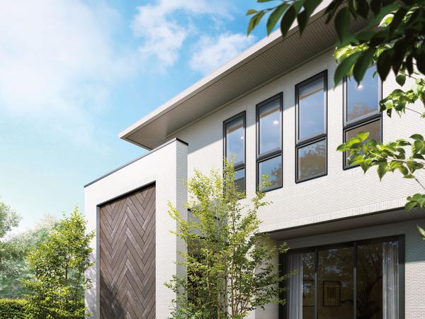 外観デザインをより一層、印象付けるのは、デザインウォールにあしらった、ヘリンボーンスタイルが映える木目調のタイル。これまでの外壁タイルの重厚感に、やわらかな温もりが加わることで、さらなるデザインの領域を広げている。