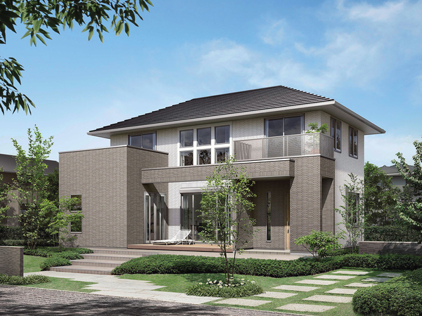 寄棟屋根の堂々たるファサードが印象的なデザイン。洗練された2色使いの外壁タイルには、深みと柔らかさのある横ラインが特長のタイルを用い、住まいに豊かな風合いと温もりを演出している