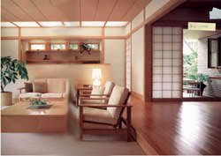 サッシの枠材から柱、天井材まで木調で統一。障子を通した柔らかな光と影とあいまって、より深いくつろぎ感を演出