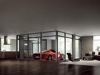 室内側の耐力壁をほとんど必要としない「Gウォール構法」のメリットを生かし、大空間の中央にガラス張りのガレージを組み込んだプラン。ガラスはドアやサッシなので行き来もスムーズ