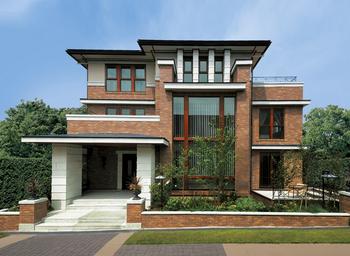 外観バリエーション例 3:水平ラインを基調にブリックタイルや天然石を利用した風格あふれる3階建て2世帯住宅(同社モデルハウス)