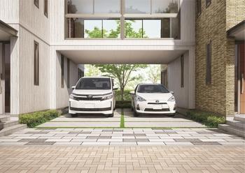 三階建だから実現できる、二台並列可能な門型のインナーガレージ。広いスペースは多目的に使えるほか、室内と直接つながる便利さで、クルマのある暮らしのさまざまな場面にゆとりを生み出す