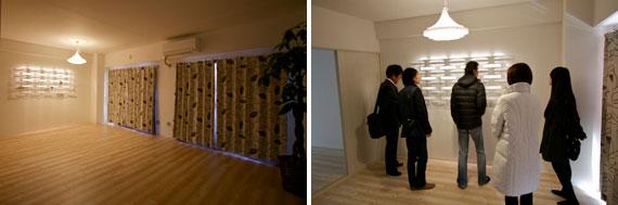 【画像5】遮光カーテンによって、夜のイメージをつくってみた。家賃は7万8000円で、普通の部屋よりも3000円から4000円程度アップされている。当日は学校の先生方や施工会社の担当者も訪れていた(写真撮影:井村幸治)