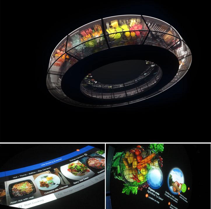 【画像18】会場の上部から吊り下げられた透明な円形のキッチンを舞台に、空中で二人の俳優が未来のキッチン・ワークを寸劇で見せた。冷蔵庫内の材料をサーチし、レシピを提案。画面に現れる手順で配膳まで導いてくれる。IoT時代のキッチンは、見えない部分に膨大なデータやセンサーが存在するというメッセージか(写真提供/Miele)