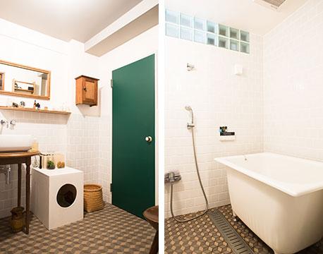 【画像5】洗面所とバスルームの壁にはタイルを張り天井はグレーにペイント。かつてヨーロッパで流行ったという幾何学模様のタイルを敷き詰めた床がアクセントに。アンティークのテーブルと洗面ボウルを組み合わせた洗面台はオリジナリティがあり目を惹く(写真撮影/片山貴博)