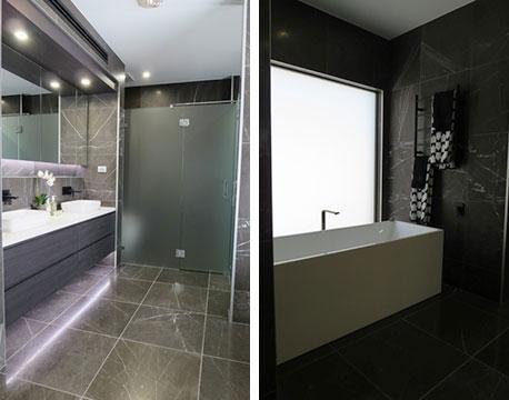 【画像17】主寝室のバス洗面トイレはホテルライク。洗面の向こうはシャワーブース、右手の浴槽にも窓からの自然光(写真撮影/藤井繁子)