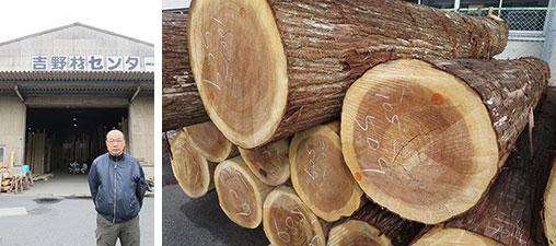 【画像15】吉野製材工業協同組合の上田理事長。市場で見た杉の原木、径や単価がチョークで書かれている(写真撮影/藤井繁子)