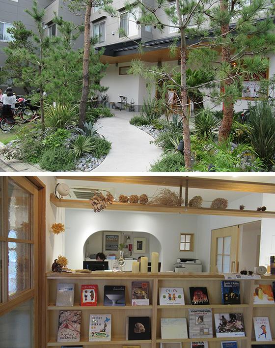 【画像1】緑に囲まれた建物に入ると玄関の先に、開放的な受付兼執務スペース。子どもに人気の児童書『ぐりとぐら』などの絵本も目に入る(写真撮影/近藤智子)