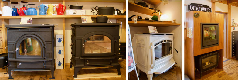 【画像2】薪ストーブには豊富なバリエーションがある。左:いずれもアメリカ製の「ダッチウエスト」。中:白いカラーが特徴のアメリカ製「クワドラファイア」。右:左側の木製ラックの下はベルギー製の「ドブレ」。ブラウン管テレビのような形状が特徴(写真撮影/井村幸治)