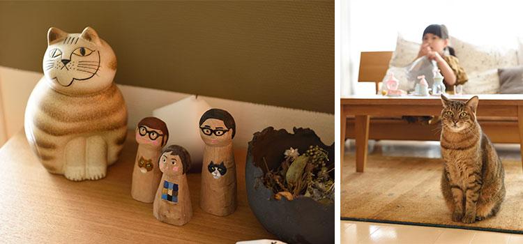 陶器の猫の横にさりげなく飾られた田中さんファミリーの木彫り人形。よく見ると胸に愛猫2匹も描かれています(写真撮影/山出高士)