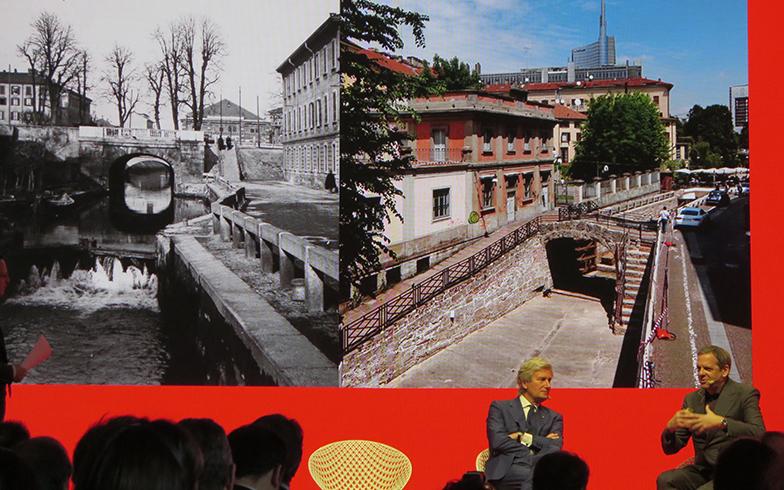 記者会見でBalich氏(右)がミラノサローネ のLutiプレジデント に、過去と現在の運河写真を紹介しながら企画への思いを語った。「ルネサンスの名残りとミラノの未来を語るインスタレーションになる」(写真撮影/藤井繁子)